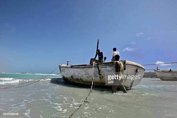 Photo taken on January 7 2010 shows armed Somali pirates carrying out preparations to a skiff in Hobyo northeastern Somalia ahead of new attacks on...