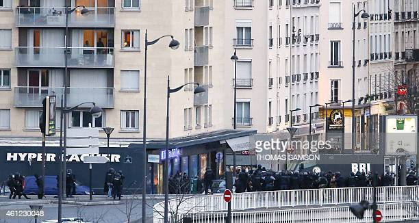 A photo taken on January 9 2015 shows a general view of members of the French police special forces launching the assault at a kosher grocery store...