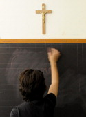 LAFFON A photo taken on July 1 2010 shows a teacher cleaning a blackboard under a crucifix in a classroom of a school in Viterbo The European Court...
