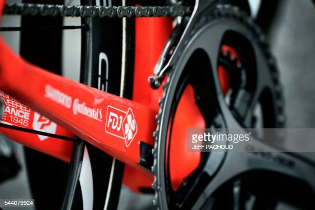 A photo taken on July 1 2016 shows an FDJ logo on a bike in front of France's FDJ cycling team's hotel in Coutances a day before the start of the...