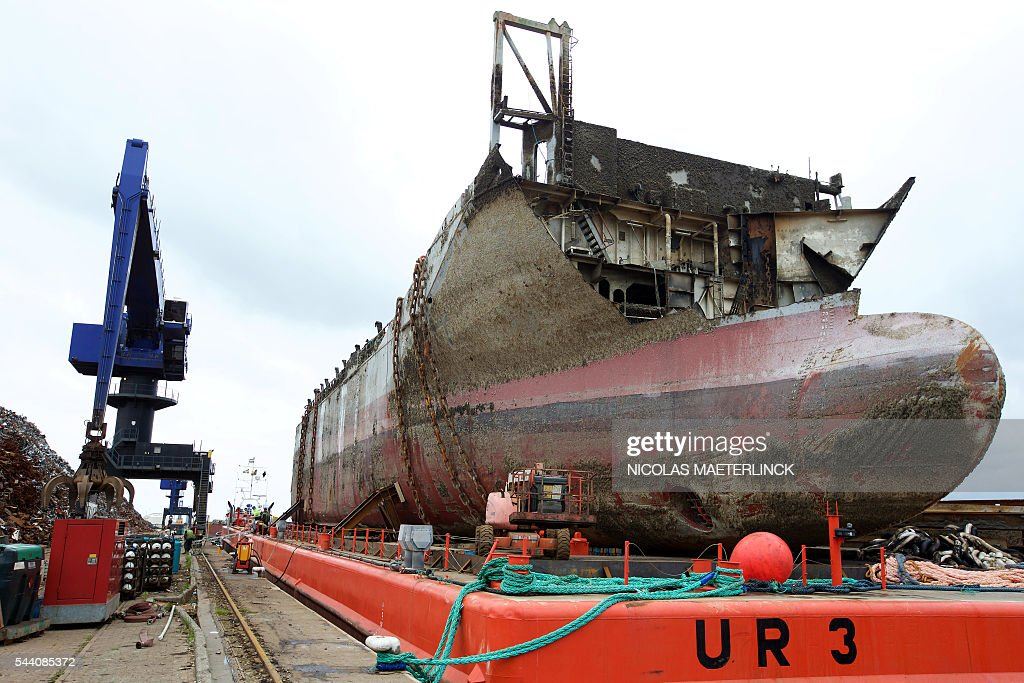 A photo taken on July 1, 2016 shows the arrival of the first pieces of the wreckage of the Flinterstar cargo ship in Gent. On October 6 the Dutch cargo ship Flinterstar and the gas tanker Al-Oraiq collided in the North Sea some 8km off the coast of Zeebrugge, after which the Flinterstar sank. There were no hazardous materials aboard the sunken ship but oil leaked into the sea. / AFP / BELGA / NICOLAS MAETERLINCK / Belgium OUT