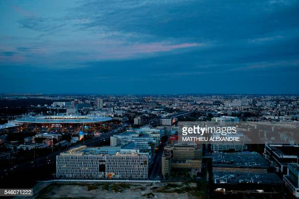 TOPSHOT A photo taken on July 10 2016 shows a general view of SaintDenis Paris northern suburb and the Stade de France / AFP PHOTO / MATTHIEU...