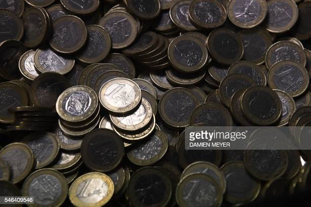 A photo taken on July 12 2016 shows euro coins at the security and protection company Brink's in Rennes western France AFP PHOTO / DAMIEN MEYER / AFP...