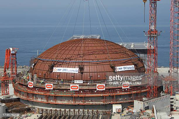 A photo taken on July 16 2013 in Flamanville northwestern France shows a dome after its installation on a reactor's building on the construction site...