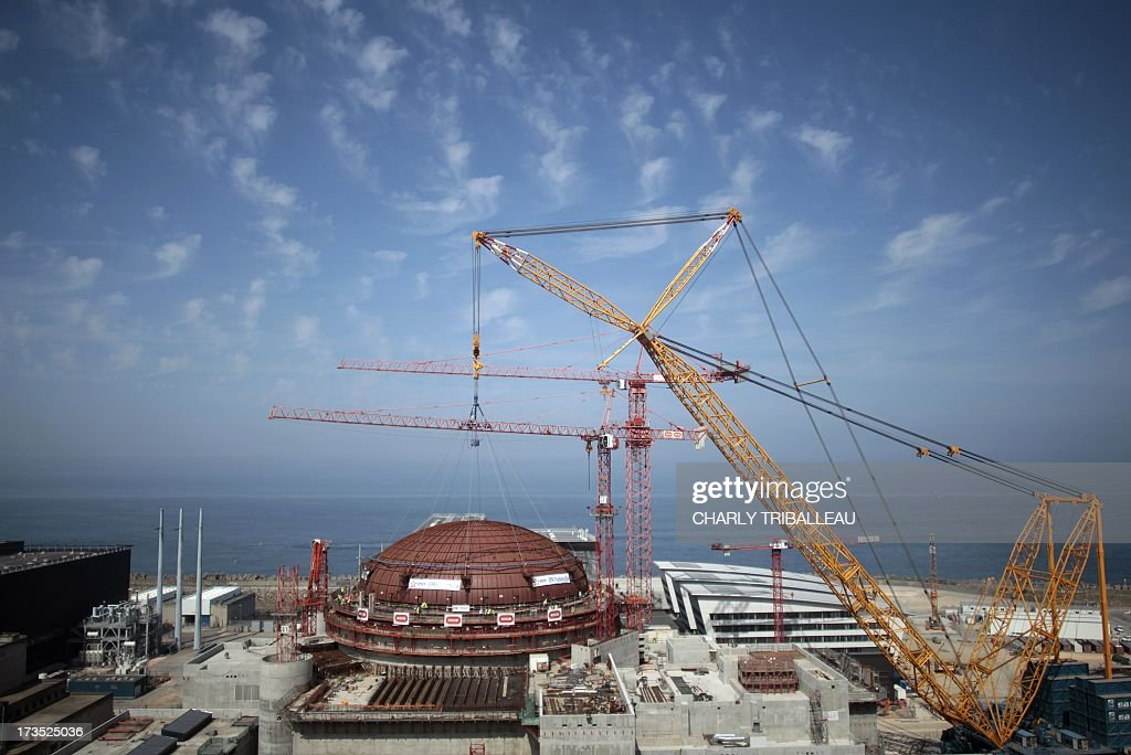A photo taken on July 16, 2013 in Flamanville, northwestern France, shows a 154 meter high hoist owned by the Sarens company, used on the construction site of the third European generation Pressurised Water Reactor (EPR), to install a dome on the reactor's building. The nuclear reactor will be put into service at the end of the year 2016, said EDF director of the future nuclear station Didier Ohayon on June 20, 2013.
