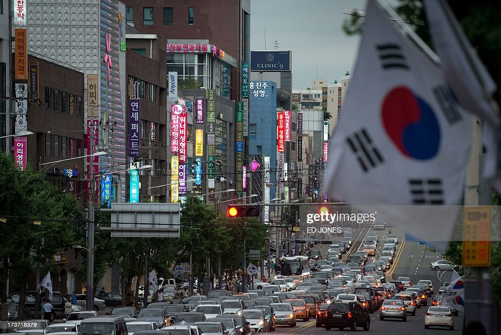 A photo taken on July 16, 2013 shows a general view of a prominent plastic surgery street in Seoul. Skilled plastic surgeons in looks-obsessed South Korea are enjoying an unexpected boom as increasing numbers of foreigners seek aesthetic absolution in what is fast becoming the cosmetic procedure capital of the world. According to government data, overall medical spending by foreign visitors hit a record 116 million US dollars in 2011. Almost a half of all foreigners seeking a nose job, a facelift, a jawbone reduction or a tummy tuck were from China. Their number nearly tripled from 1,657 in 2009 to 4,400 in 2010. Clinics are are also reporting sweilling customer numbers from Japan, the Middle East, Africa, Veitnam, and Mongolia. AFP PHOTO / Ed Jones