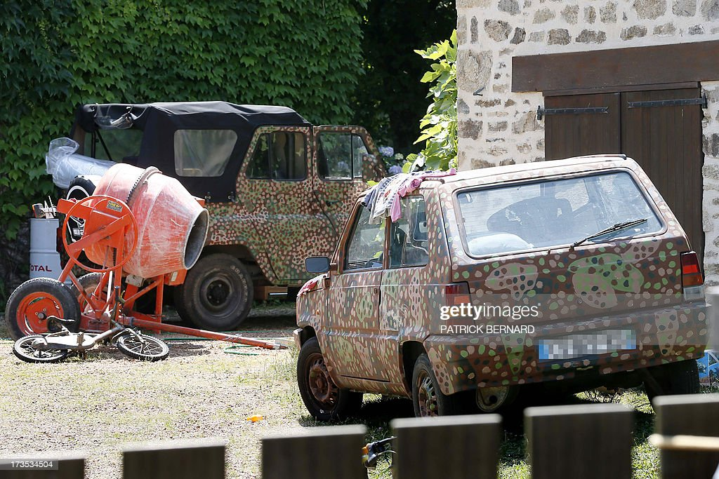 A photo taken on July 16, 2013 shows cars parked outside the house of Norwegian neo-Nazi black metal rocker and convicted killer, Kristian Vikernes, in the hamlet of Las Fleyras near the village of Salon La Tour outside the central French city of Limoges. Vikernes, who is reportedly a sympathizer of Norwegian mass killer Anders Behring Breivik, was arrested by intelligence officers at dawn at his home as was his French wife Marie Cachet, 25. The French Interior Ministry said the 40-year-old who goes by the stage name 'Varg' is 'close to the neo-Nazi movement' and could have been preparing a 'major terrorist act.' Vikernes, who was once sentenced to 21 years in prison in Norway for stabbing to death one of his friends, had been under surveillance for several years. AFP PHOTO / PATRICK BERNARD