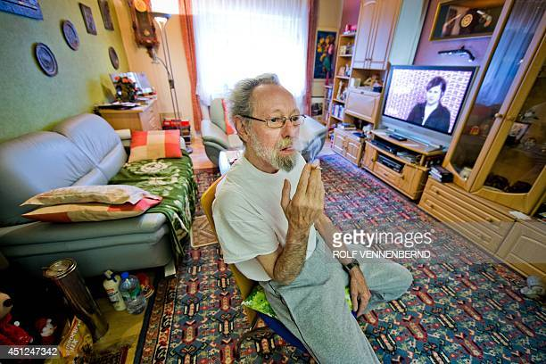 A photo taken on July 17 2013 shows German elderly Friedhelm Adolfs smoking in the living room of the flat he lived in in Duesseldorf northwestern...