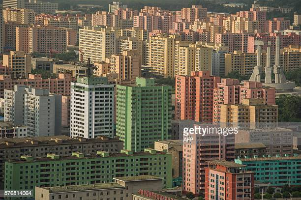 A photo taken on July 17 2016 shows apartment buildings and the Monument to the Founding of the Workers Party amongst the Pyongyang skyline seen from...