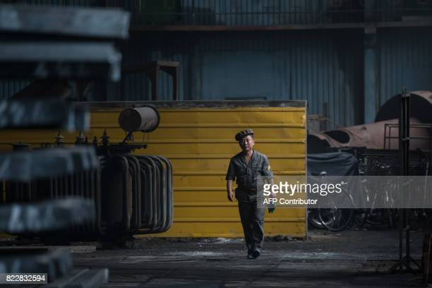 TOPSHOT A photo taken on July 22 2017 shows a worker walking through the Chollima Steel Complex southwest of Pyongyang The Chollima Steel Complex has...