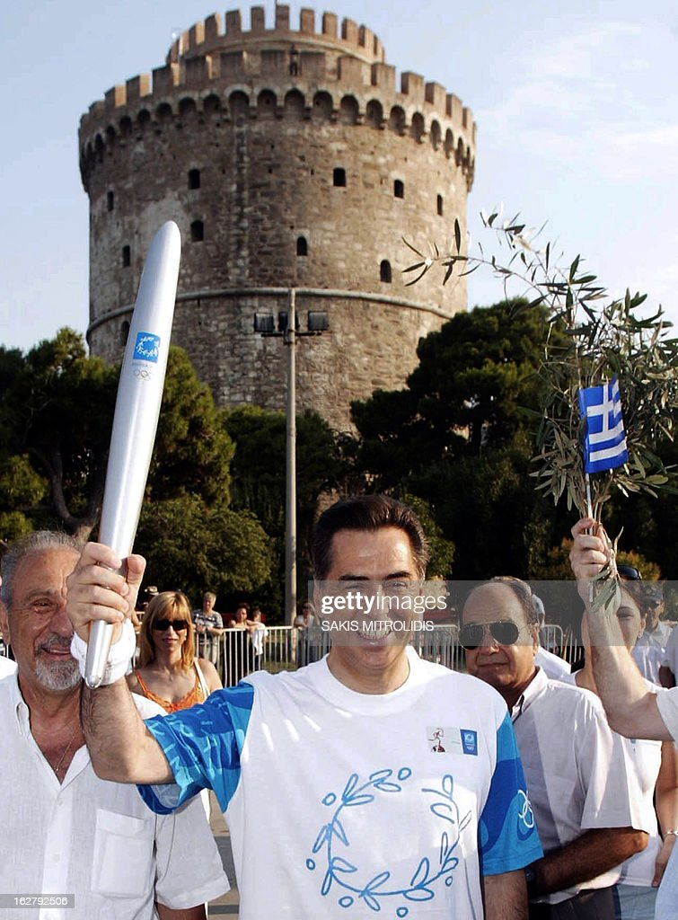 A photo taken on July 24, 2004 shows the former Mayor of the Greek northern port city of Thessaloniki Vassilis Papageorgopoulos posing with the Olympic torch during the Athens' 2004 Olympic torch relay. A court in Thessaloniki, northern Greece, on February 27, 2013 handed life sentences to the city's ex-mayor and two other municipal officials in a decade-long embezzlement case, local officials said. Vassilis Papageorgopoulos, 65, was convicted of turning a blind eye to the embezzlement of nearly 18 million euros ($23.5 million) from municipal coffers between 1999 and 2008. PHOTO / Sakis Mitrolidis