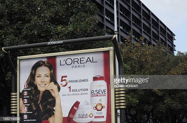 A photo taken on July 28 2010 in Clichy outside Paris near the world's largest cosmetics maker' headquarters French group l'Oreal shows an billboard...