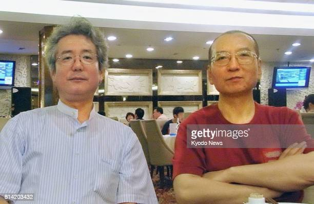 Photo taken on July 30 shows Chinese dissident Liu Xiaobo and his interviewer Yasuhiro Mori of Kyodo News at a restaurant in Beijing Liu who won the...
