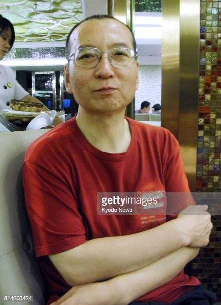 Photo taken on July 30 shows Chinese dissident Liu Xiaobo being interviewed at a restaurant in Beijing Liu who won the Nobel Peace Prize in 2010 died...