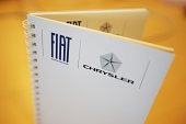 A photo taken on July 31 2014 shows the logo of Fiat Chrysler on a notebook at Fiat Headquarters at Lingotto in Turin Shareholders in Italian...