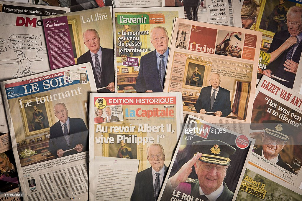 Photo taken on July 4, 2013 in Brussels shows the covers of Belgian newspapers on the abdiction announcement of King Albert II. Belgium's King Albert II announced his abdication on July 3 in favour of his son, saying that after two decades at the helm of the tiny country he felt too old and frail to continue. AFP PHOTO / BELGA PHOTO / SISKA GREMMELPREZ
