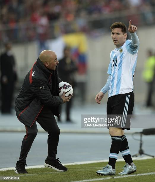 Photo taken on July 4 2015 of Argentina's forward Lionel Messi and Chile's coach Jorge Sampaoli during their 2015 Copa America final football match...