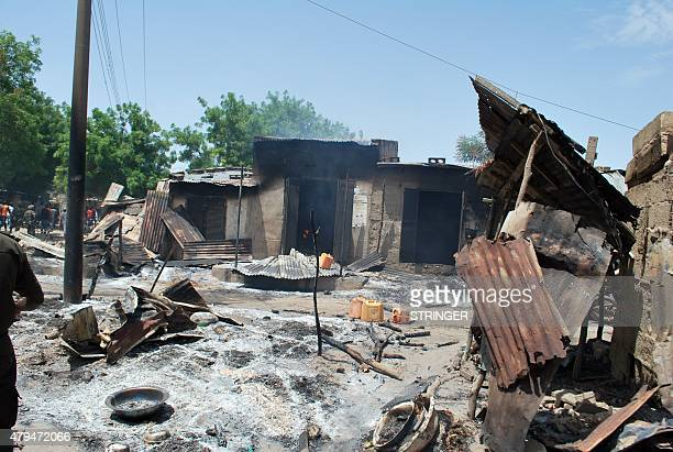 A photo taken on July 4 2015 shows houses burnt by Boko Haram fighters at Zabarmari a fishing and farming village near Maiduguri northeast Nigeria...