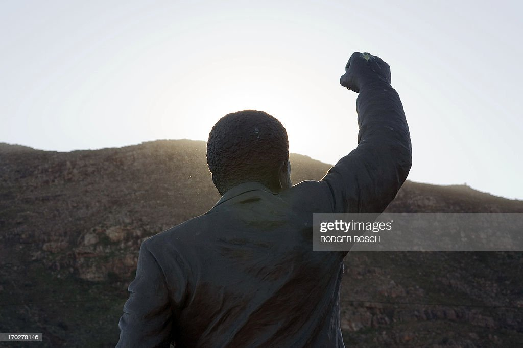 A photo taken on June 10, 2013 shows the back of a statue of Nelson Mandela, former South African President, and Nobel Peace Laureate, outside Drakenstein Prison close to Paarl, about 75Km from Cape Town. The 94 year-old former statesman has been admitted to hospital with a recurring lung infection, and a spokesman describes his condition as 'serious, but stable'. This Prison was where Mandela ended his 27 years of imprisonment, and walked out a free man in 1990.