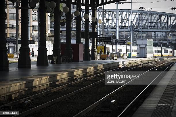 A photo taken on June 12 2014 in Paris shows tracks at the Gare du Nord railway station on the second day of a national strike by French SNCF railway...