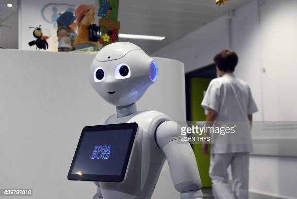 A photo taken on June 13 2016 shows the robot Pepper during a press conference oat the CHR Citadel hospital centers of Liege the CHR Citadel hospital...