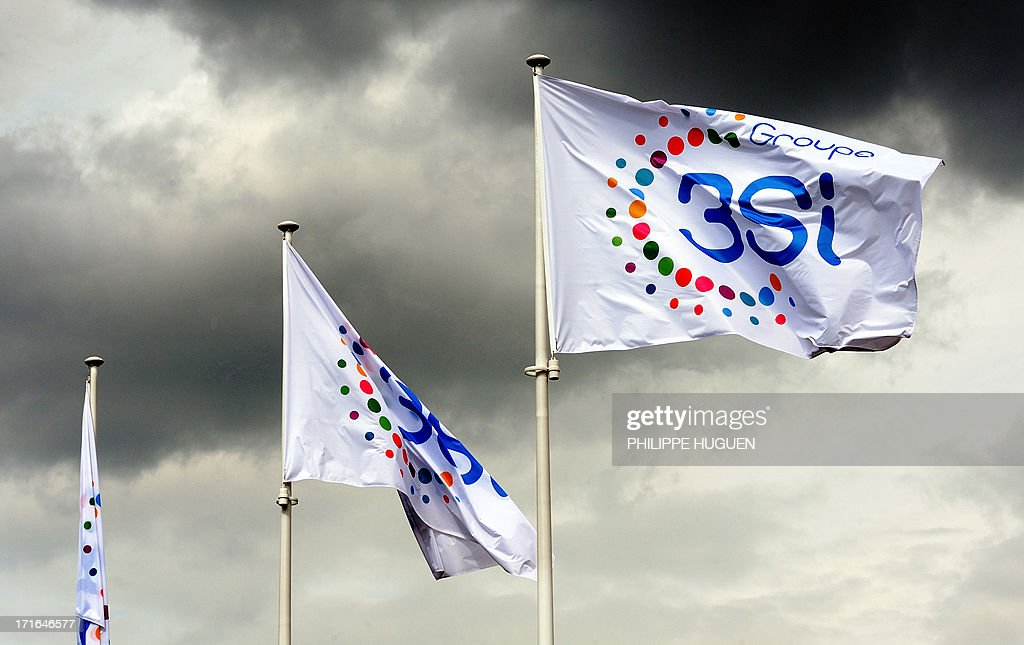 Photo taken on June 27, 2013 shows the flag of 3 Suisses International (3SI) group, at the group's headquarters in Villeneuve-d'Ascq, France on June 27, 2013. Denis Terrien, director general of 3SI, announced on June 27 that the German group Otto, the second world leader in e-commerce, has proposed to buy the bulk of 3SI's e-commerce activities. AFP PHOTO / PHILIPPE HUGUEN