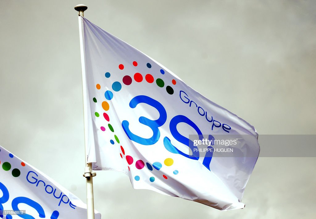 Photo taken on June 27, 2013 shows the flag of 3 Suisses International (3SI) group, at the group's headquarters in Villeneuve-d'Ascq, France on June 27, 2013. Denis Terrien, director general of 3SI, announced on June 27 that the German group Otto, the second world leader in e-commerce, has proposed to buy the bulk of 3SI's e-commerce activities.