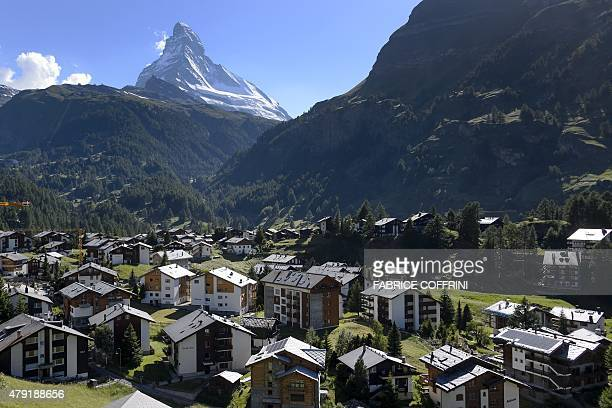 A photo taken on June 30 2015 shows the village of Zermatt with the Matterhorn mountain in the background The resort celebrates this year the 150th...