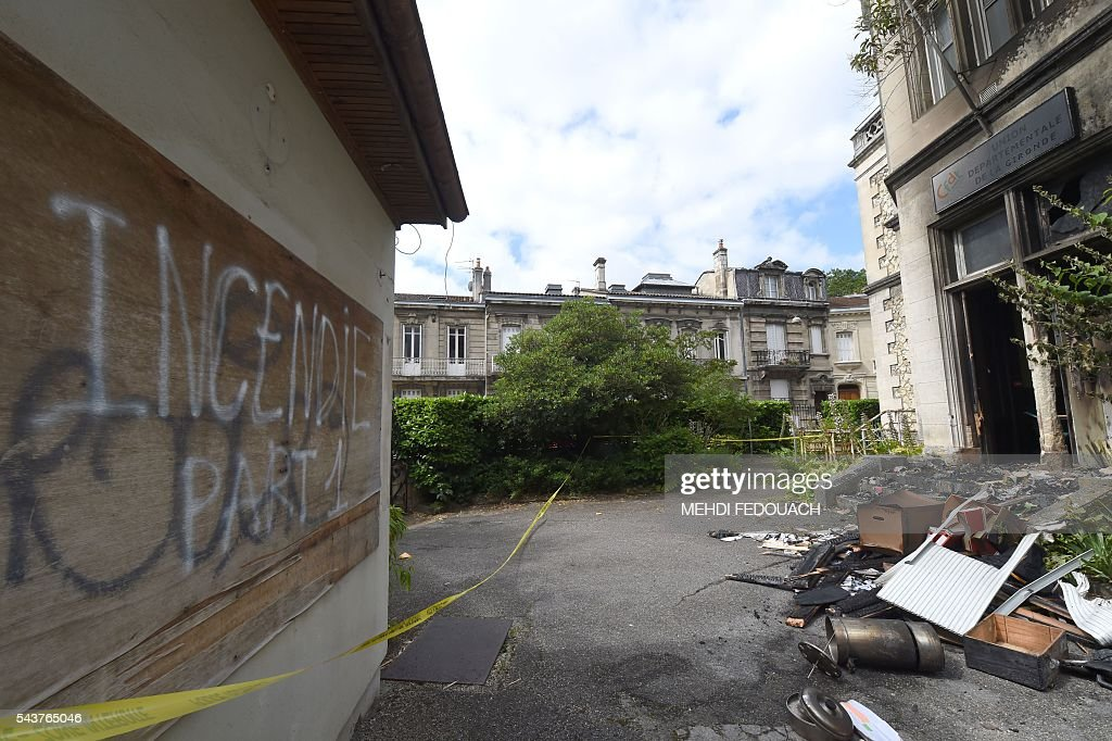 A photo taken on June 30, 2016 in Bordeaux, shows objects and the facade of the headquarters of the local French CFDT trade union after being damaged overnight by a intentional garbage fire set in front of the building. / AFP / Mehdi FEDOUACH