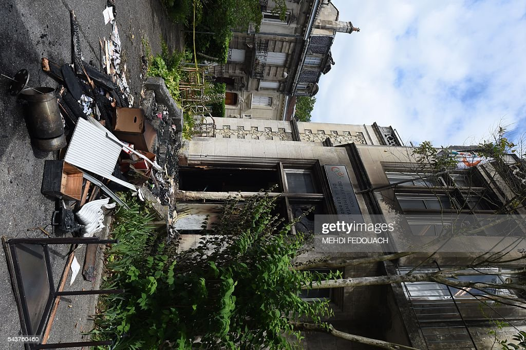 A photo taken on June 30, 2016 in Bordeaux, shows the facade of the headquarters of the local French CFDT trade union after being damaged overnight by a intentional garbage fire set in front of the building. / AFP / Mehdi FEDOUACH