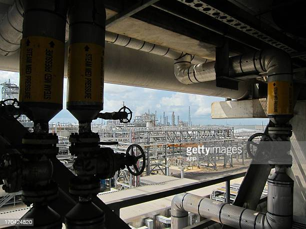 A photo taken on June 6 2013 shows a partial view of French oil giant Total's Texan plant in Port Arthur AFP PHOTO / MARC PREEL