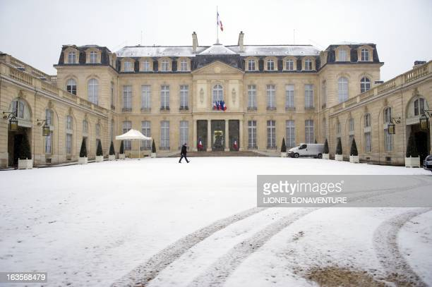 A photo taken on March 12 2013 shows the courtyard of the Elysee presidential palace in Paris covered with snow Eurostar suspended crossChannel train...