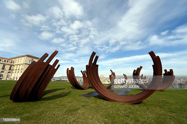 A photo taken on March 12 2013 shows the monumental steel sculptures 'Desordre' of French conceptual artist Bernar Venet in the southern French city...
