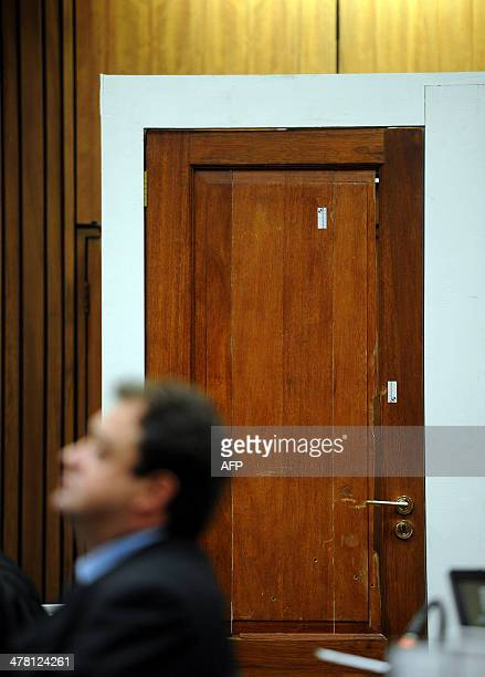 A photo taken on March 12 2014 shows the bathroom door which South African Paralympian Oscar Pistorius broke down on the night he shot dead his...