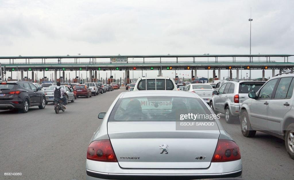 A photo taken on March 13, 2017 show toll booths off Henri Konan bridge in Abidjan. /