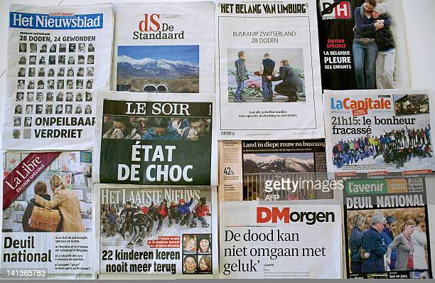 A photo taken on March 15 2012 in Brussels shows the front pages of Belgian newspapers featuring the March 13 bus crash in Sierre in the Swiss canton...
