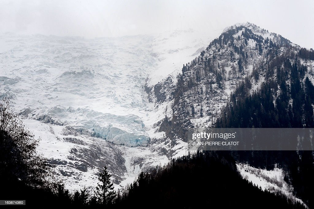 Photo taken on March 17, 2013 at Chamonix-Mont-Blanc shows the Bossons glacier where a 48 year-old Briton and his 12 year-old son set off for a walk the previous day . Their bodies were found by rescuers today in the Bossons area. AFP PHOTO / Jean Pierre Clatot