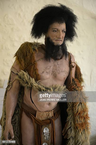 A photo taken on March 19 2014 at the new Abri de CroMagnon museum in Les EyziesdeTayacSireuil central western France shows a wax model of a...