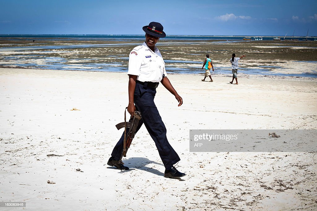 Photo taken on March 2, 2013 shows a Kenyan police officer patrolling along Bamburi beach in the city of Mombasa. Many tourists traveling with families are confident and stay in Mombasa during the general elections taking place on March 4, 2013.