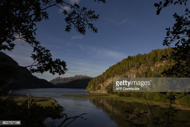 Photo taken on March 20 2010 of the Arrayanes river and the Verde lake at Los Alerces national park in the Patagonian province of Chubut Argentina...