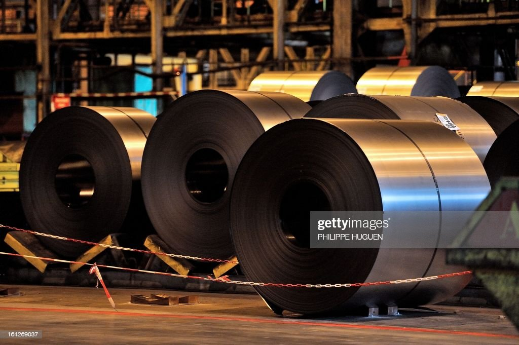 A photo taken on March 21, 2013 shows steel coils at the Arcelor Mittal steel plant in Grande-Synthe, northern France.