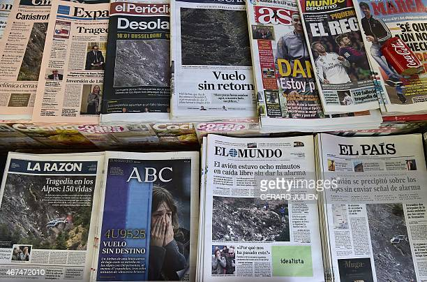 A photo taken on March 25 2015 in Madrid shows front pages of various Spanish newspapers a day after a Germanwings Airbus A320 coming from Barcelona...