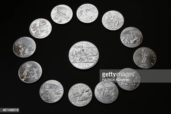 Photo taken on March 25 2015 shows a new series of twelve coins illustrated with Asterix designs entitled 'Asterix and the values of the Republic'...