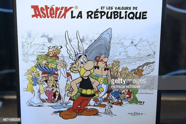 Photo taken on March 25 2015 shows the envelope containing a new series of twelve coins illustrated with Asterix designs entitled 'Asterix and the...