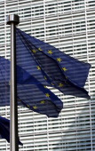 A photo taken on March 27 2007 shows European flags at the entrance of the European Commission's Berlaymont building at the EU headquarters in...
