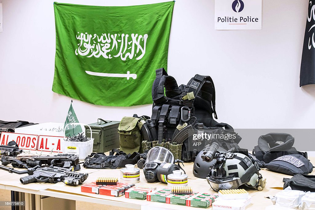 A photo taken on March 27, 2013 in Brussels shows paramilitary equipment, weapons and ammunition discovered on March 26 by the police in the Anderlecht flat of a man suspected of terrorist links. Police shot dead the man, of Algerian origin, after he opened fire on them on March 26. Officers had been investigating him following a tip-off from French authorities. They had already linked him to one recent robbery and moved in to arrest him after receiving information that he might be planning another crime.