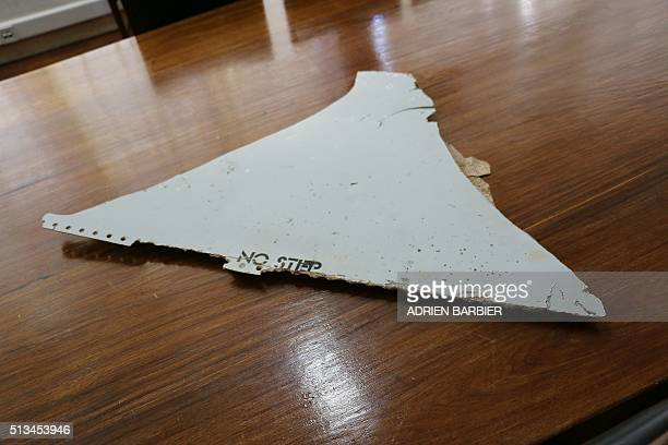 A photo taken on March 3 2016 shows a piece of suspected aircraft wreckage found off the east African coast of Mozambique at Mozambique's Civil...
