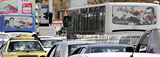 A photo taken on March 4 2015 shows buses with posters bearing portraits of Syrian President Bashar alAssad in the city of Damascus AFP PHOTO / LOUAI...