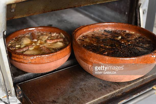 A photo taken on March 4 2016 shows a cassoulet in the kitchen of JeanClaude Rodriguez head chef of the Chateau Saint Martin restaurant in...