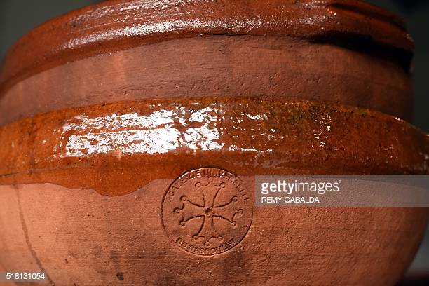 A photo taken on March 4 2016 shows a cassoulet pot bearing the seal of the Academie Universelle du Cassoulet in the kitchen of JeanClaude Rodriguez...